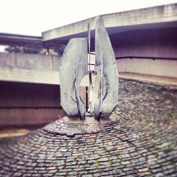 Untitled by Austin Wright (1967), in the middle of the ramp leading to the library