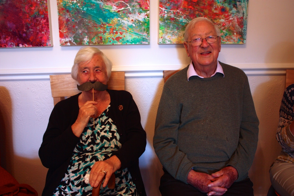 My Granny and Grandpa - Granny making the most of the moustaches that I made for the party!