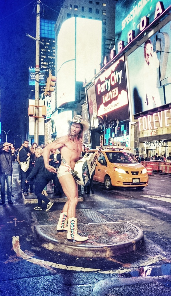 The Naked Cowboy entertaining the crowds...