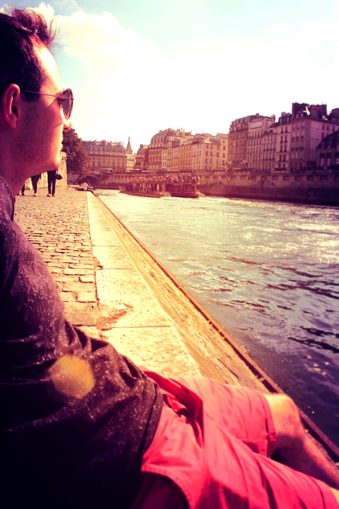 Malek enjoying the sun and Seine.