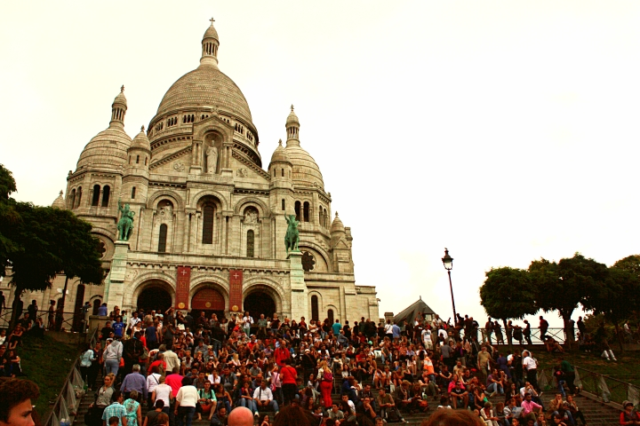 Crowds of people sitting in front of the Sacre-Coeur taking in the amazing views!