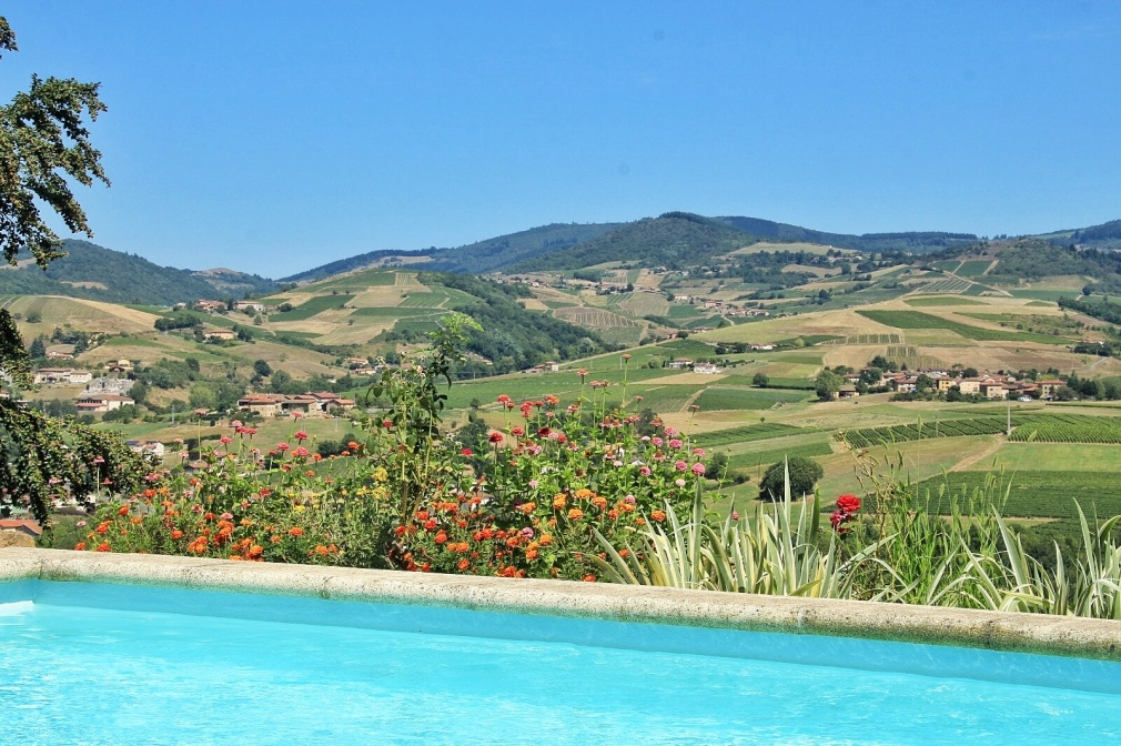 Holiday in Ternand France, view by the swimming pool of the countryside